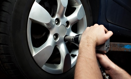 Wheel Balancing or $300 Towards New Tires at United Auto Service (Up to 52% Off)