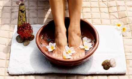 One or Three Detoxifying Ionic Footbaths at With Pure Heart Center For The Healing Arts (Up to 54%Off)