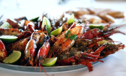 Creole-Inspired Cuisine at Bourbon Street Bar and Grill (Up to 43% Off). Two Options Available.