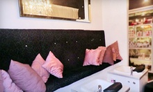 $49 for a 60-Minute Luxe Organic Body Massage with Hot Stones at Luxe Beauty Lounge