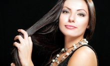 $30 for a Haircut, Shampoo and Deep Conditioning Treatment  at Paradise Salon