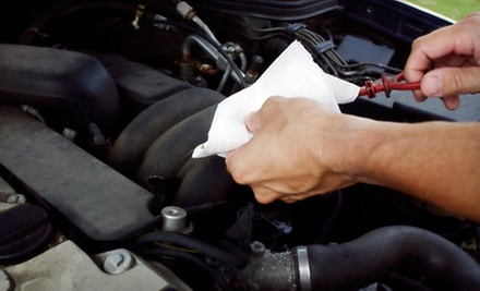 $15 for a Tire Rotation, Brake Check, and Fluid Top-Off at Top Tech Auto Repair