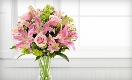 $21 for a Flower Arrangement  at Finishing Touch Florist &amp; Gifts