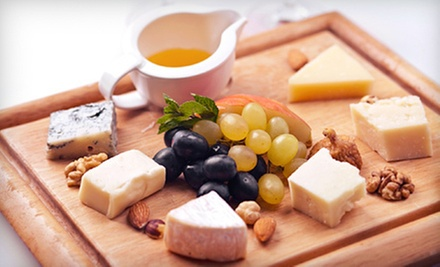 $25 for a Flight of 5 Wines, a Glass of Wine and Hors D&#x27;Oeuvres at Sweet Grapes Wine Bar