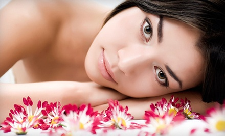 $90 for Hot Stone Massage and Sauna or Hyrdro Soak at The Spa at the Village