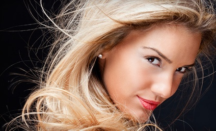 $50 for a Custom Facial at Escape Salon and Spa - Glen Ellyn