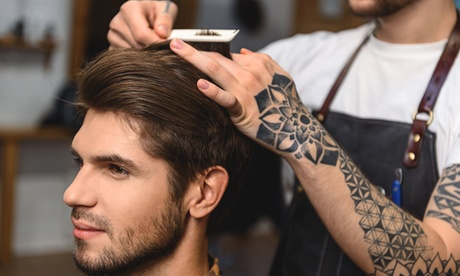 One or Two Men's Haircuts with Hot Towel, Neck Shave, and Scalp Massage at Manscapers (Up to 50% Off)