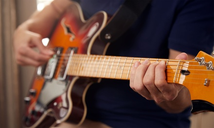 Two or Four 30-Minute Guitar, Bass, or Ukulele Lessons at Maughan Studios School of Music (Up to 55% Off)
