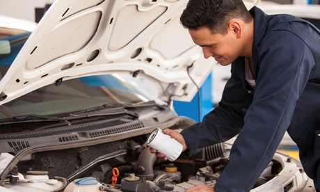 Full-Synthetic or Mobil 1 Oil Change with Tests and Inspection at Pit Stop Motors (Up to 65% Off)
