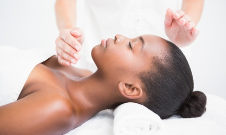 One 60-Minute Reiki, Acupressure with Body Tuner, or Sound Therapy Session at Total Realm Spa (Up to 35% Off)