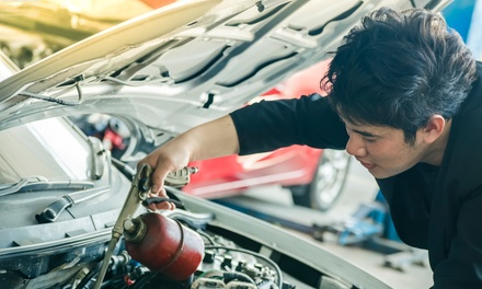 Oil Change with Optional Tire Rotation Package at Meineke Car Care Center (Up to 64% Off). 3 Options Available.