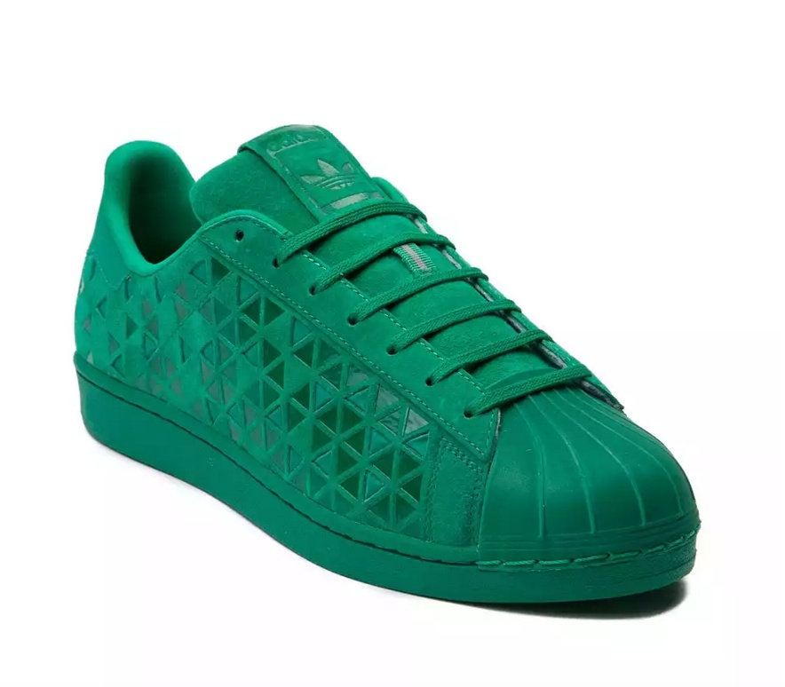 green Adidas shoes at Journeys