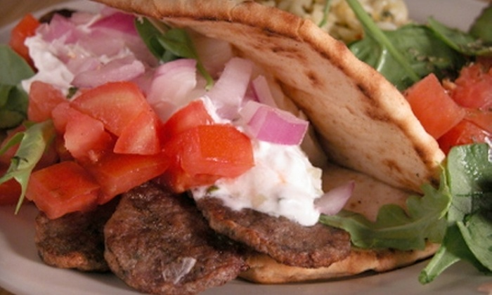The Grille - Akron / Canton: $20 for a Three-Course Greek Dinner for Two at The Grille Sunday–Thursday (or $30 for Friday and Saturday) (Up to $60 Value)