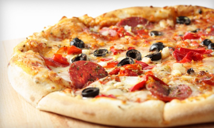 Game Town Pizza - Stone Oak: Pizza and Play Package for Four or Italian Fare and Games at Game Town Pizza