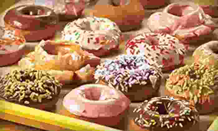 Daylight Donuts - San Antonio: $9 for a Baker's Dozen of Donuts, Four Coffees, and a Kolache at Daylight Donuts ($18.88 Value)