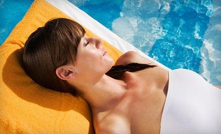 1 Month of Unlimited Tanning in a Regular Bed (a $39 value) - SunDazzle Tanning in East Syracuse