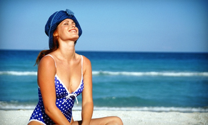 Tanning Oasis - Charleston: Two VersaSpa Spray Tans or One Month of Unlimited UV Tanning at Tanning Oasis (Up to 62% Off)