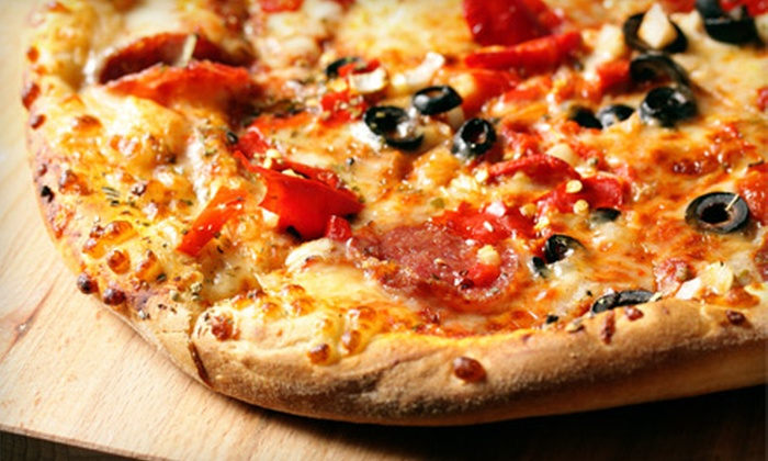 Zesto Pizza - Flamingo / Lummus: $16 for a Pizza Meal with Salad, Garlic Bread, and Soda for Three at Zesto Pizza in Miami Beach ($33.45 Value)