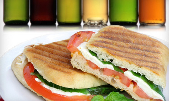 Adam Dalton Distillery - Downtown Asheville: $15 for a Panini Meal with Chips for Two and a Take-Home Six-Pack of Beer at Adam Dalton Distillery (Up to $34 Value)