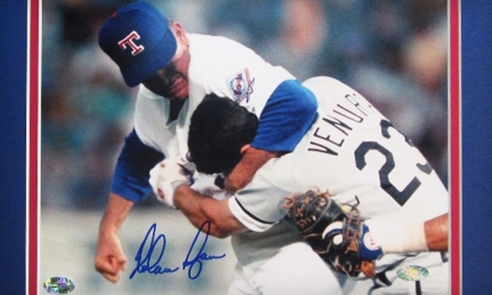 """Powers Collectibles: $139 for a Framed 8""""x10"""" Autographed Photo of Nolan Ryan Punching Robin Ventura from Powers Collectibles ($268.95 Value)"""