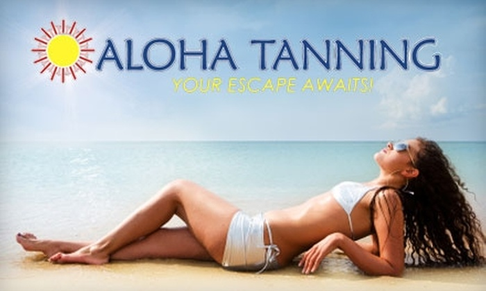 Aloha Tanning - Multiple Locations: $24 for Choice of Two Mystic Spray-Tans or One Month of Unlimited UV Tanning at Aloha Tanning (Up to $89.95 Value)