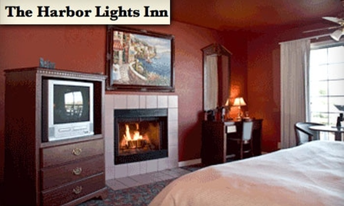 The Harbor Lights Inn - Depoe Bay: $265 for Two-Night Stay, Bottle of Wine, Bouquet of Flowers, and Breakfast at The Harbor Lights Inn (Up to $573 Value)