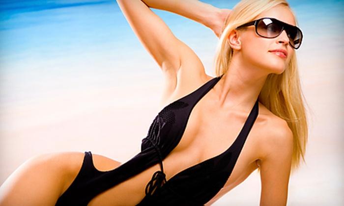The Bronzing Bar Tanning Salon - Bradenton: One Month of Unlimited UV Tanning or Two Organic Spray Tans at The Bronzing Bar Tanning Salon in Bradenton