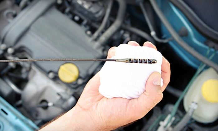 Dennis Dillon Auto Park - Multiple Locations: One or Three Oil Changes or a Two-Way Wheel Alignment at Dennis Dillon Auto Park (Up to 58% Off)