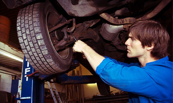 Smog Mart Plus - Smog Mart: One or Two Oil and Filter Changes, Tire Rotations, and Inspections at Smog Mart Plus (Up to 58% Off)