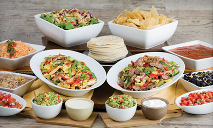 Sharky's Woodfired Mexican Grill - Multiple Locations: Mexican Fare or Burrito Party Pack at Sharky's Woodfired Mexican Grill (Up to Half Off). Two Locations Available.