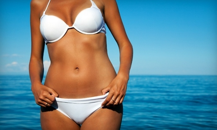 Paradise Tan - Wellington: Professional Airbrush Tan or Three Tanning Bed Sessions at Paradise Tan in Wellington