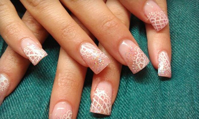 Naturally Nails - Potowomut: Basic Mani & Spa Pedi or Gel Mani, Spa Pedi, & Sugar Scrub with Paraffin Treatment at Naturally Nails (Up to 52% Off)