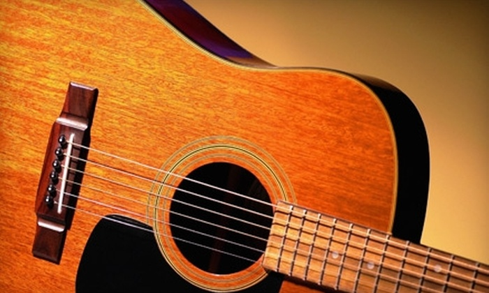 Robinson Music - Worcester: $10 for a 30-Minute Private Guitar, Drums, Piano, or Vocal Lesson at Robinson Music ($27 Value)