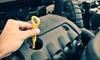 Tuffy Auto Service Center - The Woodlands: $35 for Three Oil-Change Packages and One Tire Rotation at Tuffy Auto Service Center (Up to $125 Value)