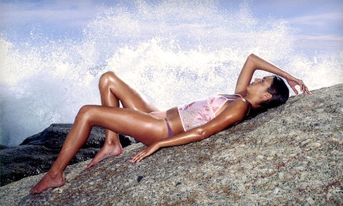 TNT Tanning - Multiple Locations: Two Weeks of Level II Tanning or Three Mystic Spray Tans at TNT Tanning