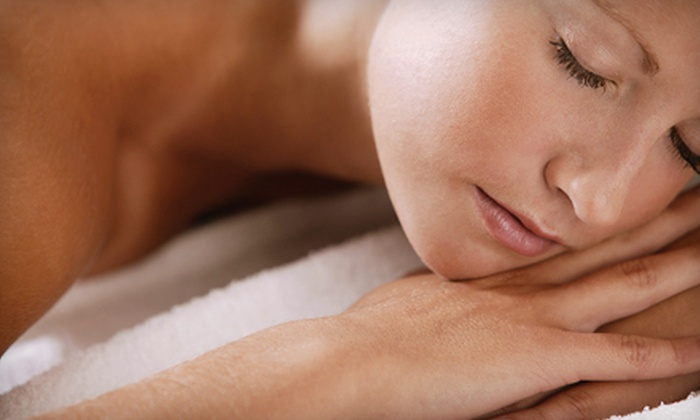 Sign of the Tymes Salon - Indianapolis: $49 for a Spa Package with a 60-Minute Massage and Spa Manicure at Sign of the Tymes Salon (Up to $99 Value)
