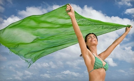 Darque Tan: 30 Days of Unlimited Mystic Spray Tanning Plus Unlimited Red-Light Therapy  - Darque Tan in Richardson