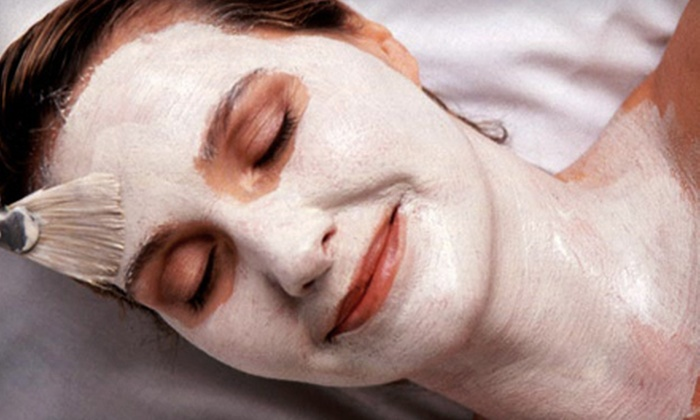 Currie Hair, Skin & Nails - Multiple Locations: Massage or 60-Minute Facial ($90 Value)