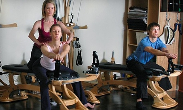Fusion Pilates Asheville - Downtown Ashville: $80 for Three Private Pilates Classes ($195 Value) or $59 for 10 Mat Classes ($110 Value) at Fusion Pilates Asheville
