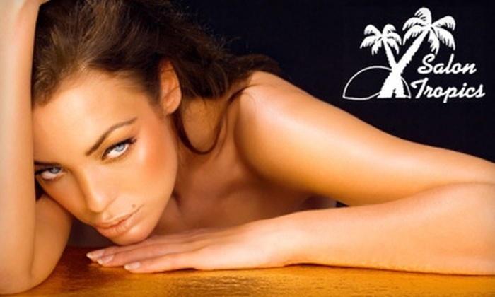 Salon Tropics - Shenandoah: $28 for One Month of Unlimited Medium-Pressure Bed-Tanning or Four Mystic Tans at Salon Tropics (Up to a $100 Value)