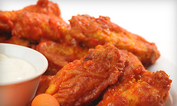 The Orange Dog Bar and Grill - Garfield: $20 for a Pub Grub Meal for Two at The Orange Dog Bar and Grill in Huntington Beach (Up to $51.33 Value)