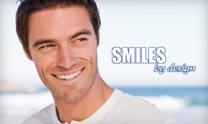Smiles by Design - Remington Park: $79 for LumaLite Teeth Whitening ($300 Value) or $59 for a Comprehensive Exam ($423 Value) at Smiles by Design