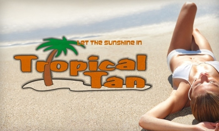 Tropical Tan - Quail Hollow: $35 for One Month of Unlimited Tanning or Four Spray Tans at Tropical Tan (Up to $140 Value)