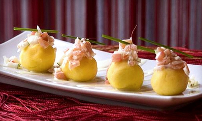 Between Peruvian Cafe & Lounge - Wicker Park: $60 for a Four-Course Peruvian Dinner for Two with Sangria at Between Peruvian Cafe & Lounge (Up to $128 Value)