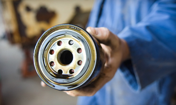 Auto One Service Center - Jacksonville: Oil Change and Tire Rotation, Brake Flush, or Air-Conditioning Treatment at Auto One Service Center