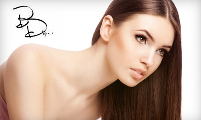 Bella D'ora Spa & Salon - Carlsbad: $149 for Brazilian Blowout ($300 Value) or $49 for a Four-Layer Facial with Eyelift Treatment ($125 Value) at Bella D'ora Spa & Salon in Carlsbad