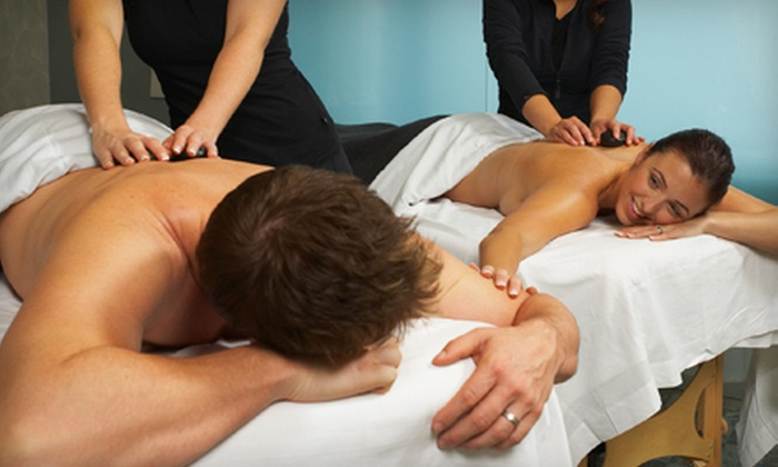 Renew Day Spa - Denmark: $65 for a Side-by-Side Massage and Paraffin-Wax Foot Treatments for Two at Renew Day Spa in Manitowoc ($130 Value)