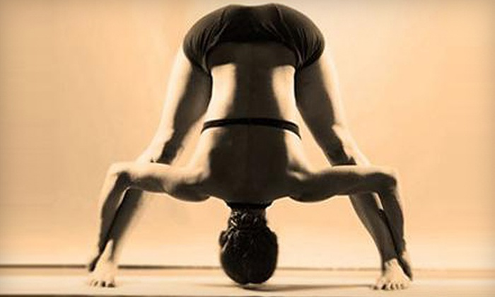 Pearland Bikram Yoga - Pearland: Five-Class Pass or One Month of Unlimited Classes at Pearland Bikram Yoga