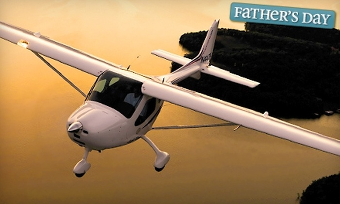 First Landings Aviation - Apopka: $60 for a Half-Hour Discovery Flight and DVD from First Landings Aviation in Apopka ($99 Value)