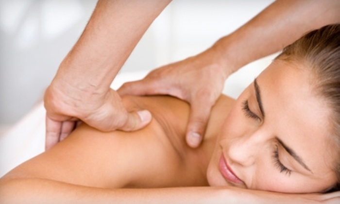 Hand & Stone Massage and Facial Spa - Multiple Locations: Massage or Facial with Aromatherapy at Hand & Stone Massage and Facial Spa. Three Locations Available.